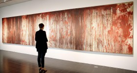 epa04336643 A visitor stands in front of the painting 'Untitled (Kreuzbluttriptychon 1)' by Austrian artist Hermann Nitsch at the 'Kunsthalle' in Hamburg, Germany, 31 July 2014. The Hamburg Kunsthalle is remaining open despite modernization works. Some 200 masterpieces from the museum's permanent collection will be on display under the title 'Spot On' at the Kunsthalle's 'Galerie der Gegenwart' (Galery of Contemporary Art) until 03 January 2016.  EPA/MALTE CHRISTIANS